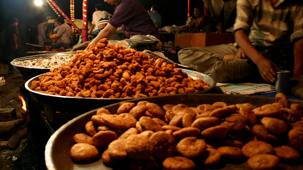 Kachori being fried in a street food market in india