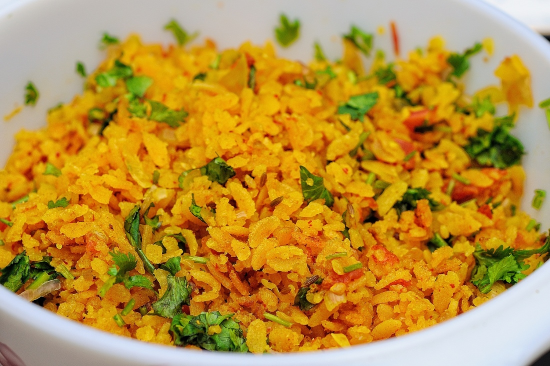 Bowl of poha, a light indian street food snack